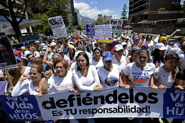 Venezuelan opposition leader Maria Corina Machado (centre) leads a demonstration against President Nicolas Maduro in Caracas, on March 8, 2015 (AFP Photo/Federico Parra)