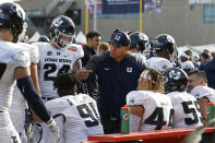 Utah State interim head coach Frank Maile, center, speaks to his players during a time out in the first half of the New Mexico Bowl NCAA college football game against North Texas in Albuquerque, N.M., Saturday, Dec. 15, 2018. (AP Photo/Andres Leighton)