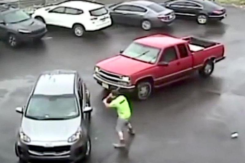 CCTV showed the moment a man attacked another driver with a sledgehammer (Handout)