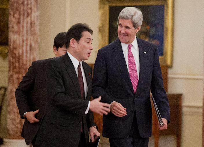 Secretary of State John Kerry walks with Japanese Foreign Minister Fumio Kishida to speak after their meeting at the State Department in Washington, Friday, Feb. 7, 2014. (AP Photo/ Evan Vucci)
