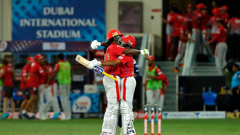 Chris Gayle and Mayank Agarwal of Kings XI Punjab celebrate their win against Mumbai Indians after the double Super Over.