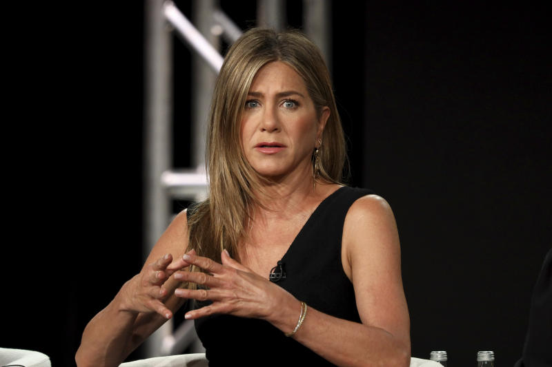 "Jennifer Aniston speaks at ""The Morning Show,"" panel during the Apple+ TCA 2020 Winter Press Tour at the Langham Huntington, Sunday, Jan. 19, 2020, in Pasadena, Calif. (Photo by Willy Sanjuan/Invision/AP)"