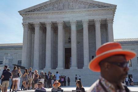 FILE PHOTO: Visitors wait to enter the U.S. Supreme Court in Washington