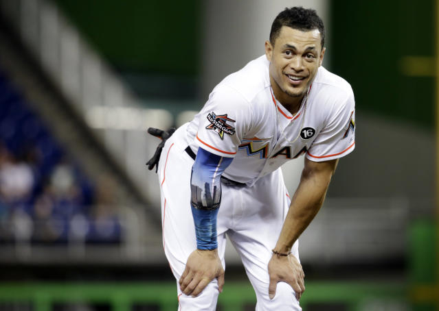 Giancarlo Stanton loves Marlins fans, but doesn't have the same feelings about the Marlins organization. (AP)