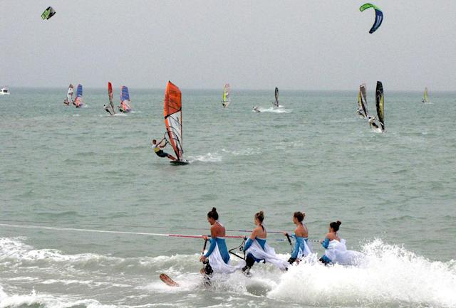 Competitors in the windsurfing World Cup sailing at Turkmenistan's new Caspian Sea resort of Avaza on July 1, 2014 (AFP Photo/)