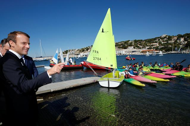 "French President Emmanuel Macron visits the site of the future Olympic Sailing venue (Voile Olympique) at the ""Marina Olympique"" nautical base in Marseille, France, after the decision for Paris to host of the 2024 Summer Olympics Games, September 21, 2017. REUTERS/Jean-Paul Pelissier"