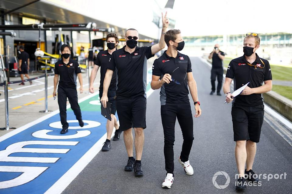 "Romain Grosjean, Haas F1 and members of the Haas team walk the track<span class=""copyright"">Andy Hone / Motorsport Images</span>"