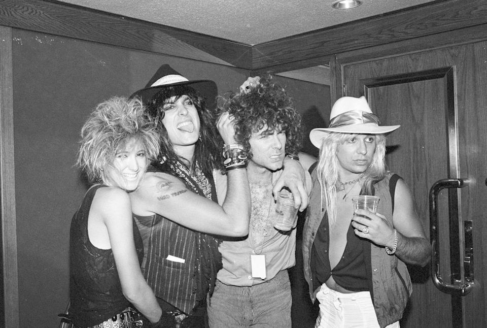 <p>Vince Neil and Tommy Lee of Mötley Crüe pose backstage at a Quiet Riot concert at the Forum on September 29, 1984 in Inglewood, California.</p>