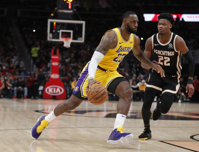 Los Angeles Lakers forward LeBron James (23) drives against Atlanta Hawks forward Cam Reddish (22) in the second half of an NBA basketball game Sunday, Dec. 15, 2019, in Atlanta. (AP Photo/John Bazemore)