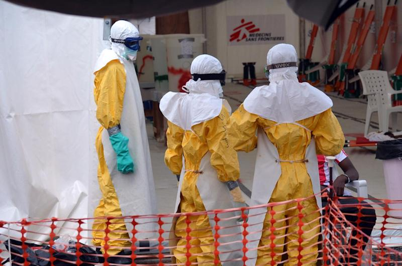 Health Workers Wearing Protective Wquipment Pictured At An Ebola Treatment Centre Run By The Non