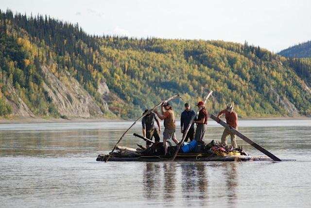 Yukon River, Alaska, USA: Matt Raney, Brent Sass, Tyler Johnson, Willi Prittie and Marty Raney on their newly built raft on the water.