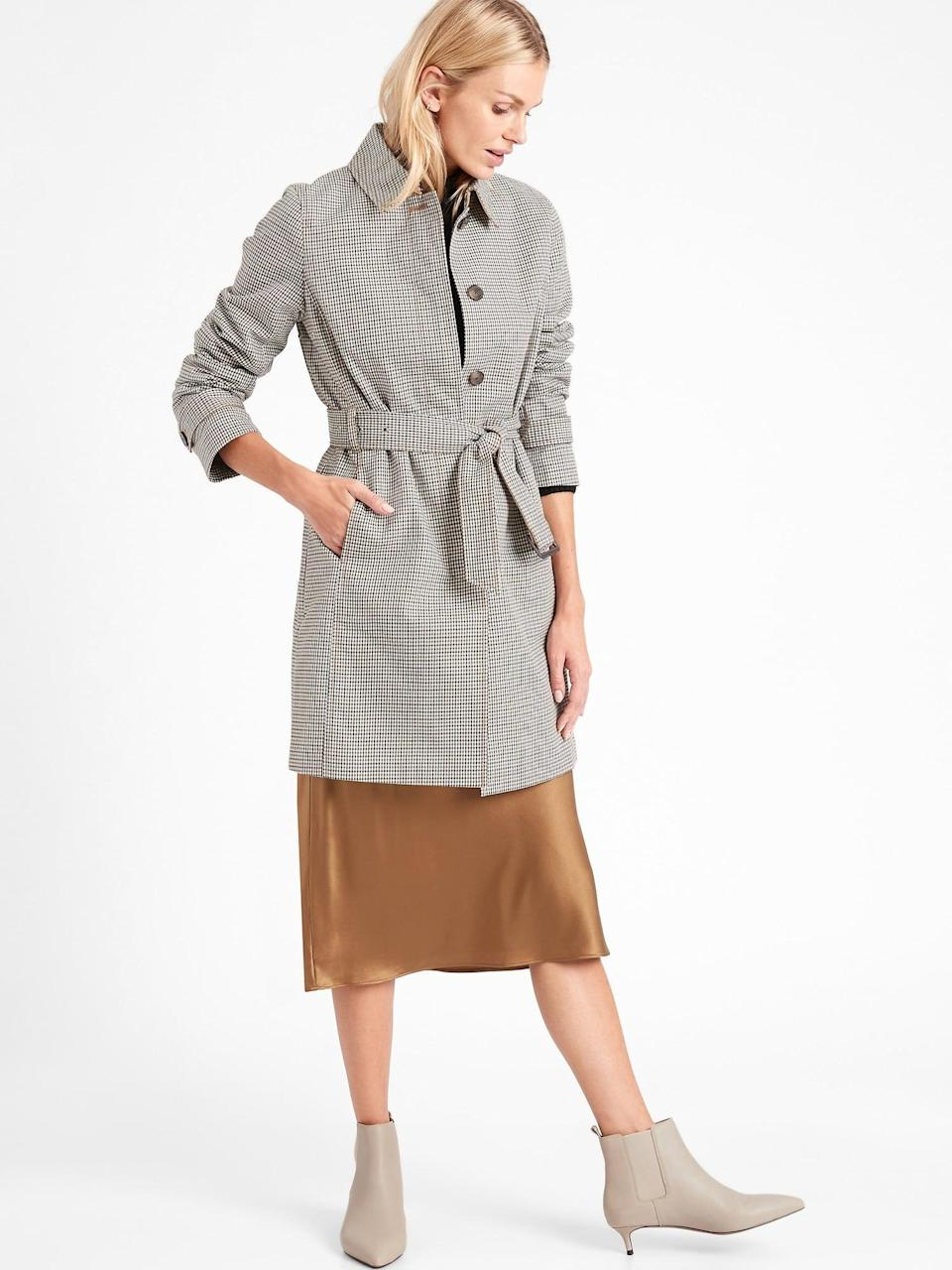 <p>Picking a patterned coat like this <span>Banana Republic Plaid Cotton Rain Coat</span> ($206, originally $229) stands out in a crowd of solids. </p>