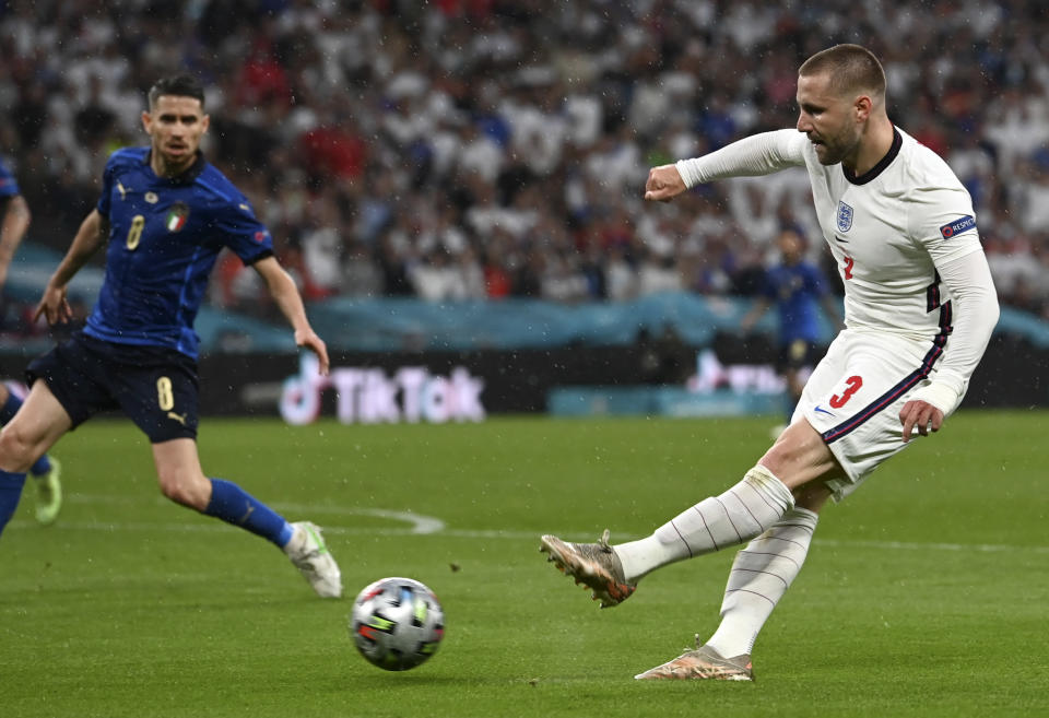 England's Luke Shaw takes a shot during the Euro 2020 soccer championship final match between England and Italy at Wembley Stadium in London, Sunday, July 11, 2021. (Paul Ellis/Pool via AP)