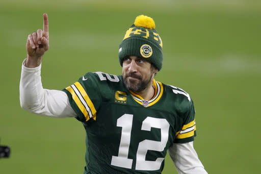 Green Bay Packers quarterback Aaron Rodgers gestures to fans after an NFL divisional playoff football game against the Los Angeles Rams Saturday, Jan. 16, 2021, in Green Bay, Wis. The Packers defeated the Rams 32-18 to advance to the NFC championship game. (AP Photo/Matt Ludtke)