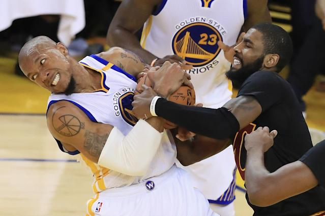 <p>David West #3 of the Golden State Warriors and Kyrie Irving #2 of the Cleveland Cavaliers fight for possesion in Game 5 of the 2017 NBA Finals at ORACLE Arena on June 12, 2017 in Oakland, California. </p>