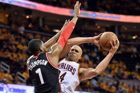 May 25, 2016; Cleveland, OH, USA; Toronto Raptors forward Jason Thompson (1) defends against Cleveland Cavaliers forward Richard Jefferson (24) during the fourth quarter in game five of the Eastern conference finals of the NBA Playoffs at Quicken Loans Arena. The Cavs won 116-78. Mandatory Credit: Ken Blaze-USA TODAY Sports