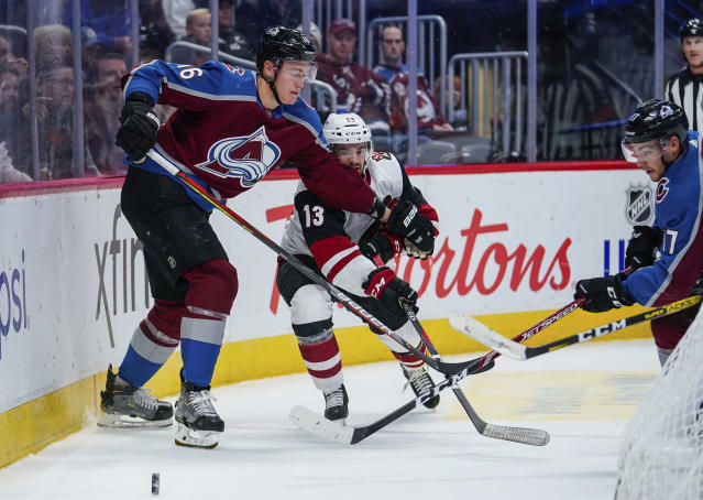 Colorado Avalanche defenseman Nikita Zadorov (16) holds back Arizona Coyotes center Vinnie Hinostroza (13) during the second period of an NHL hockey game, Saturday, Oct. 12, 2019, in Denver. (AP Photo/Jack Dempsey)