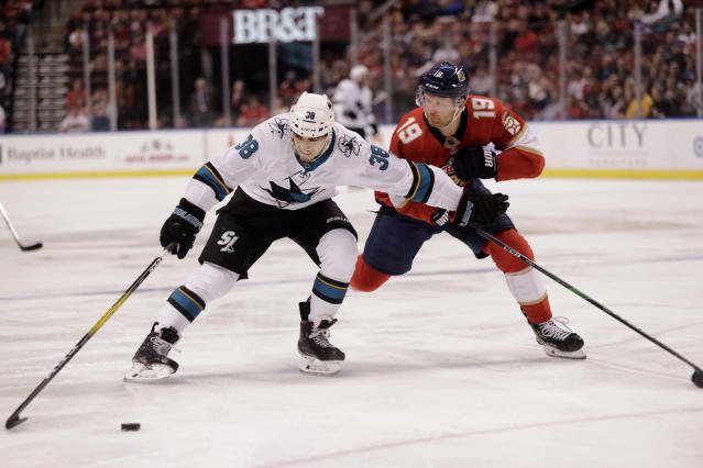 San Jose Sharks' Mario Ferraro (38) moves the puck as Florida Panthers' Mike Matheson (19) defends during the first period of an NHL hockey game, Sunday, Dec. 8, 2019, in Sunrise, Fla. (AP Photo/Luis M. Alvarez)