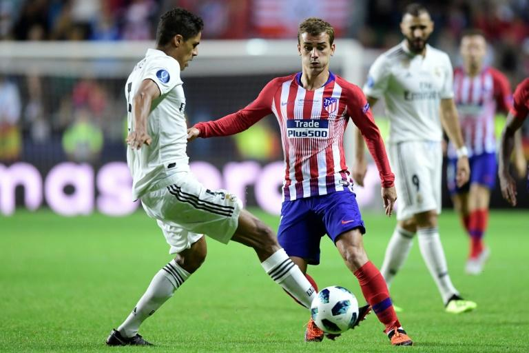 Atletico Madrid's Antoine Griezmann and Real Madrid's Raphael Varane clash during the UEFA Super Cup in Tallinn, which Atletico won in extra time