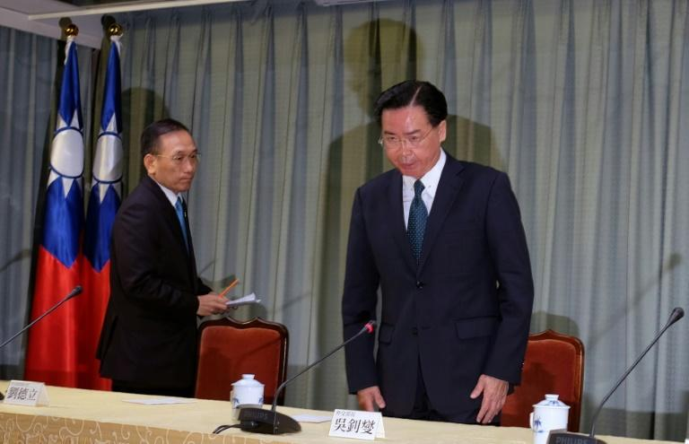 "Speaking in Taipei, foreign minister Joseph Wu, right, condemned China's ""crude actions"""