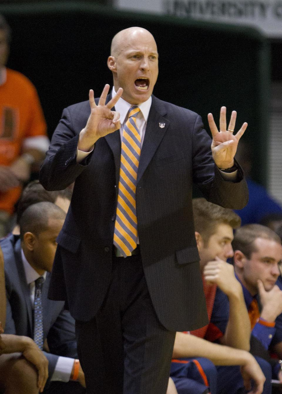 Illinois head coach John Groce calls out a play during the first half of an NCAA college basketball game against Miami, Tuesday, Dec. 2, 2014 in Coral Gables, Fla. (AP Photo/Wilfredo Lee)