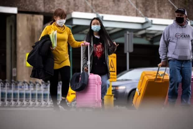 Travellers are pictured outside International arrivals at Vancouver International Airport in Richmond, British Columbia on Thursday, Dec. 31, 2020.  (Ben Nelms/CBC - image credit)