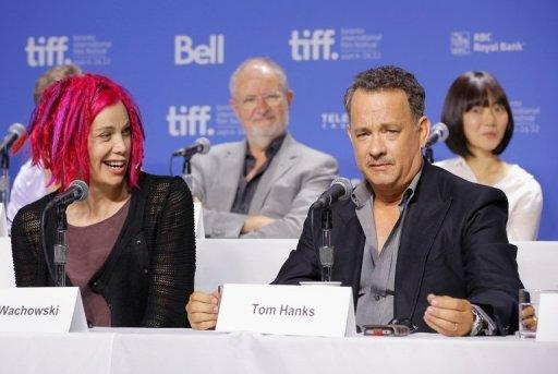 """Director Lana Wachowski and actor Tom Hanks speak onstage at the """"Cloud Atlas"""" Press Conference during the 2012 Toronto International Film Festival on September 9. """"Cloud Atlas"""" co-director Lana Wachowski this week publicly embraced her gender switch from Larry for the first time -- with bright pink dreads"""