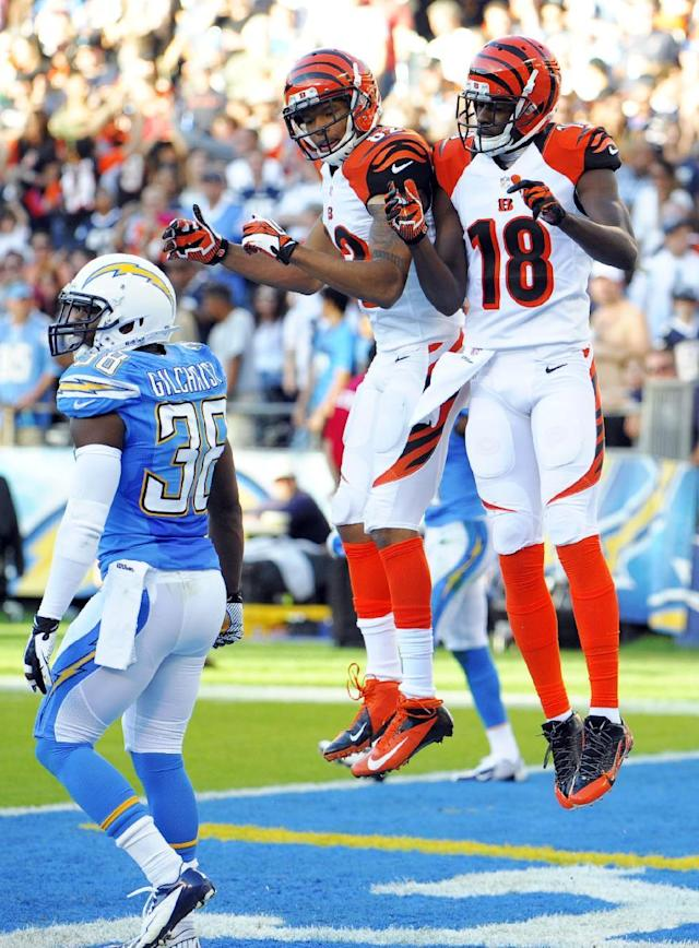 Cincinnati Bengals wide receiver A.J. Green (18) celebrates his touchdown with teammate wide receiver Marvin Jones as San Diego Chargers strong safety Marcus Gilchrist stands by at left during the second half of an NFL football game Sunday, Dec. 1, 2013, in San Diego. (AP Photo/Denis Poroy)