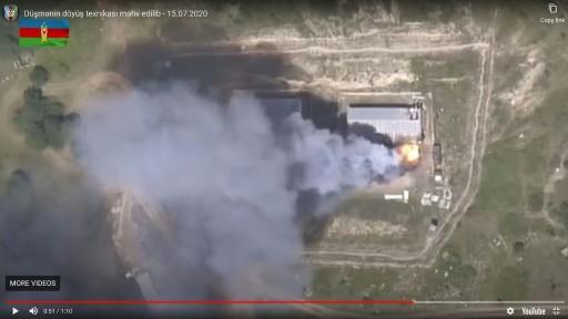 An image grab taken from a video uploaded on YouTube by the Azerbaijani Defence Ministry on July 15, 2020, allegedly shows smoke billowing from what they said was destroyed Armenia's military equipment on the Azerbaijani-Armenian border