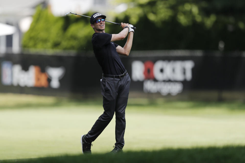 Brandon Hagy hits his approach shot on the eighth hole during the second round of the Rocket Mortgage Classic golf tournament, Friday, July 3, 2020, at the Detroit Golf Club in Detroit. (AP Photo/Carlos Osorio)