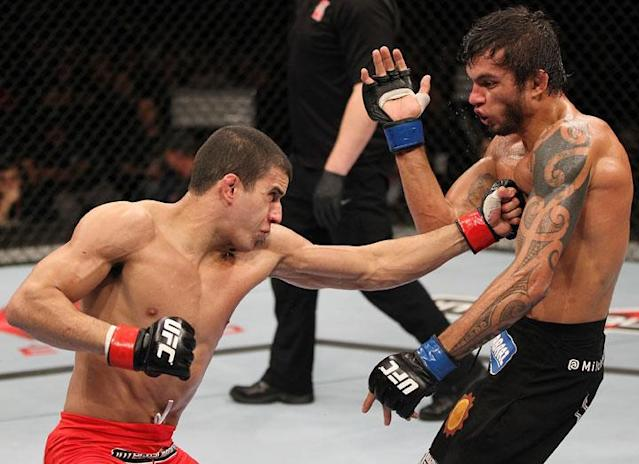 BELO HORIZONTE, BRAZIL - JUNE 23: (L-R) Felipe Arantes delivers a punch to the body of Milton Vieira during their UFC 147 featherweight bout at Estadio Jornalista Felipe Drummond on June 23, 2012 in Belo Horizonte, Brazil.