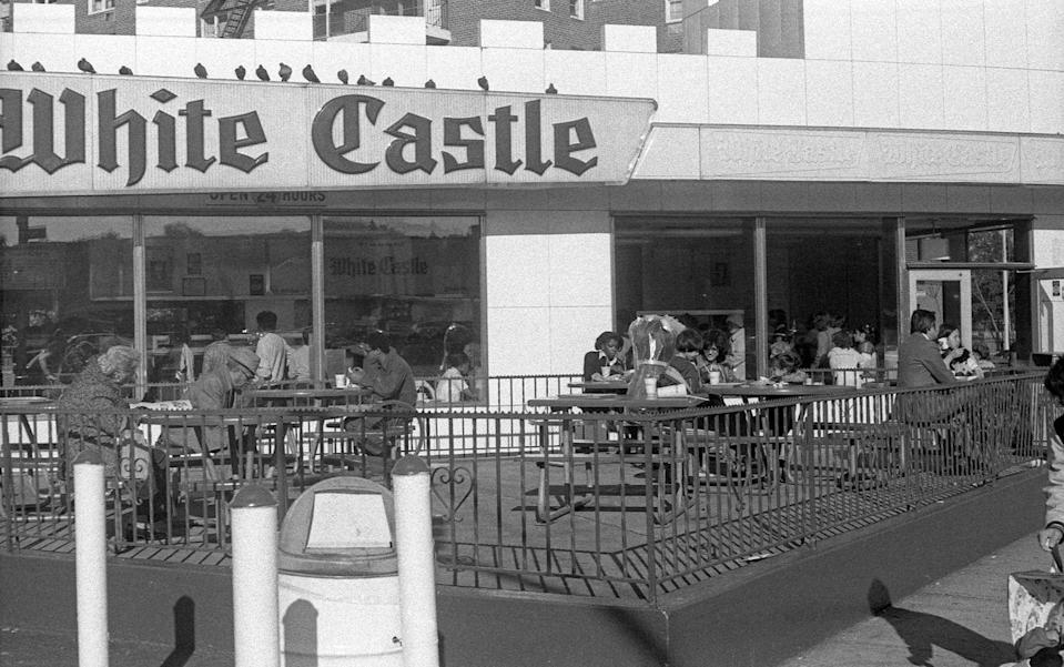 <p>This White Castle, seen on Queens Boulevard in New York in 1980 was the place to be with their crowded outdoor patio during lunchtime. </p>