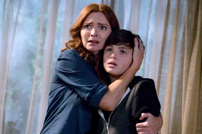 Logan Williams, with actress Brigid Brannagh, in a 2015 episode of Supernatural. (Photo: Liane Hentscher/The CW)