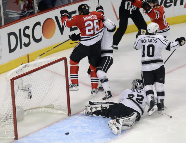 Chicago Blackhawks center Michal Handzus celebrates after scoring the game-winning goal in Game 5 of the Western Conference finals in the NHL hockey Stanley Cup playoffs against the Los Angeles Kings in the second overtime period Wednesday, May 28, 2014, in Chicago. (AP Photo/Daily Herald, Bob Chwedyk)