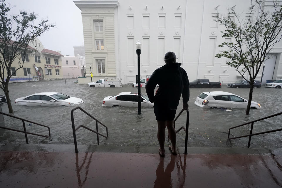 Flood waters move on the street, Wednesday, Sept. 16, 2020, in downtown Pensacola, Fla. Hurricane Sally made landfall Wednesday near Gulf Shores, Alabama, as a Category 2 storm, pushing a surge of ocean water onto the coast and dumping torrential rain that forecasters said would cause dangerous flooding from the Florida Panhandle to Mississippi and well inland in the days ahead.(AP Photo/Gerald Herbert)