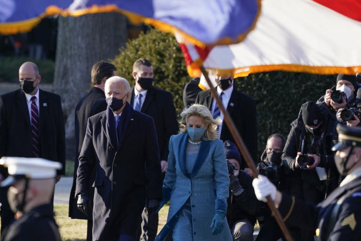 President Joe Biden and first lady Jill Biden walk toward the North Portico of the White House, Wednesday, Jan. 20, 2021, in Washington. (AP Photo/Alex Brandon, Pool)