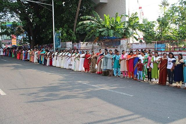 On January 2, 2019, Kerala witnessed around 3-5 million women from all walks of life get together to form a nearly 620 km long wall from Kasargod to Thiruvananthapuram. This was to protest the tradition barring women of menstrual age from entering into the Sabarimala temple. The wall, which was formed on the basis of a suggestion by Kerala's Chief Minister Pinarayi Vijayan, became the largest human chain ever formed solely by women, and the fourth largest human chain made in the world. <em><strong>Image credit: </strong></em>By Sai K shanmugam, Shanmugam Studio, Kollam - Own work, CC BY-SA 4.0, https://commons.wikimedia.org/w/index.php?curid=75487676