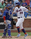 New York Mets' J.D. Davis (28) scores a run in front of Toronto Blue Jays catcher Alejandro Kirk in the sixth inning during a baseball game Sunday, July 25, 2021, in New York. (AP Photo/Adam Hunger)