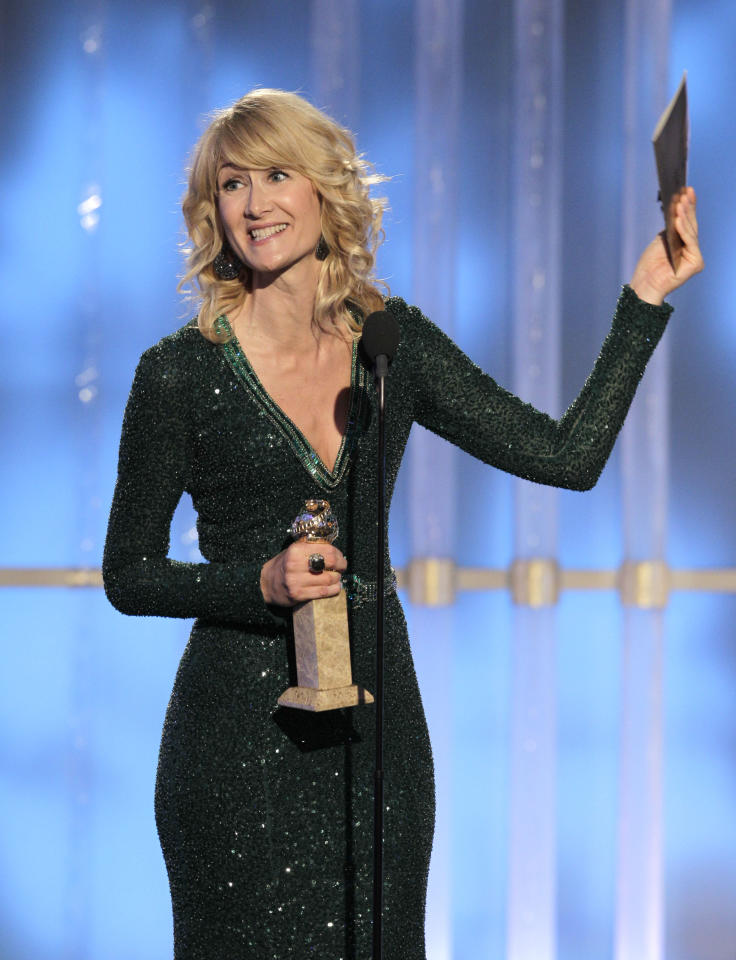 BEVERLY HILLS, CA - JANUARY 15: In this handout photo provided by NBC, actress Laura Dern accepts the Best Actress In A Comedy Series award onstage during the 69th Annual Golden Globe Awards at the Beverly Hilton International Ballroom on January 15, 2012 in Beverly Hills, California. (Photo by Paul Drinkwater/NBC via Getty Images)
