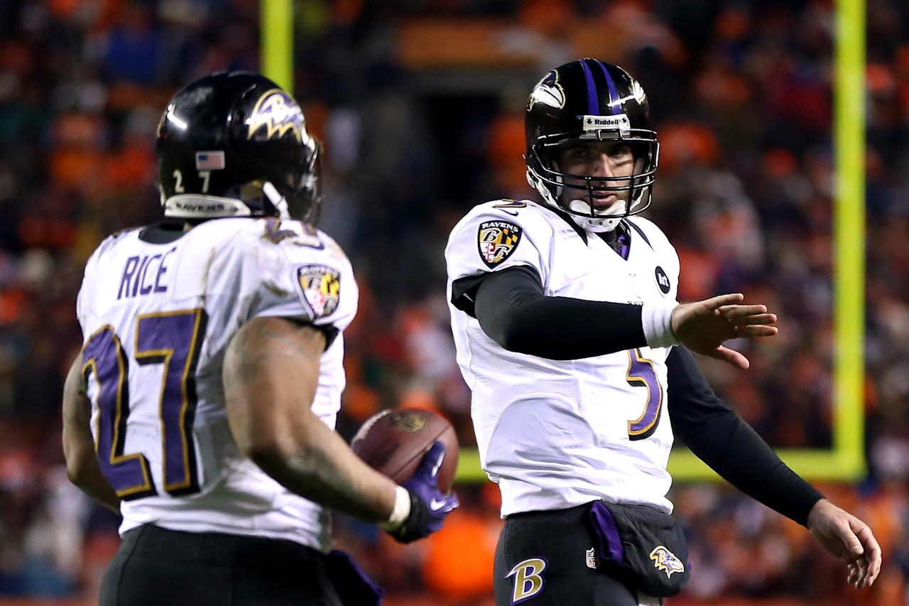 DENVER, CO - JANUARY 12:  (L-R) Ray Rice #27 and Joe Flacco #5 of the Baltimore Ravens celebrate after Rice scored a 1-yard rushing touchdown in the third quarter against the Denver Broncos during the AFC Divisional Playoff Game at Sports Authority Field at Mile High on January 12, 2013 in Denver, Colorado.  (Photo by Jeff Gross/Getty Images)