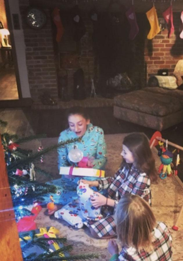 Poppy, 14, Daisy, 13, Petal, seven, and Buddy, six, opening their Xmas pressies from mum and dad. Photo: Instagram