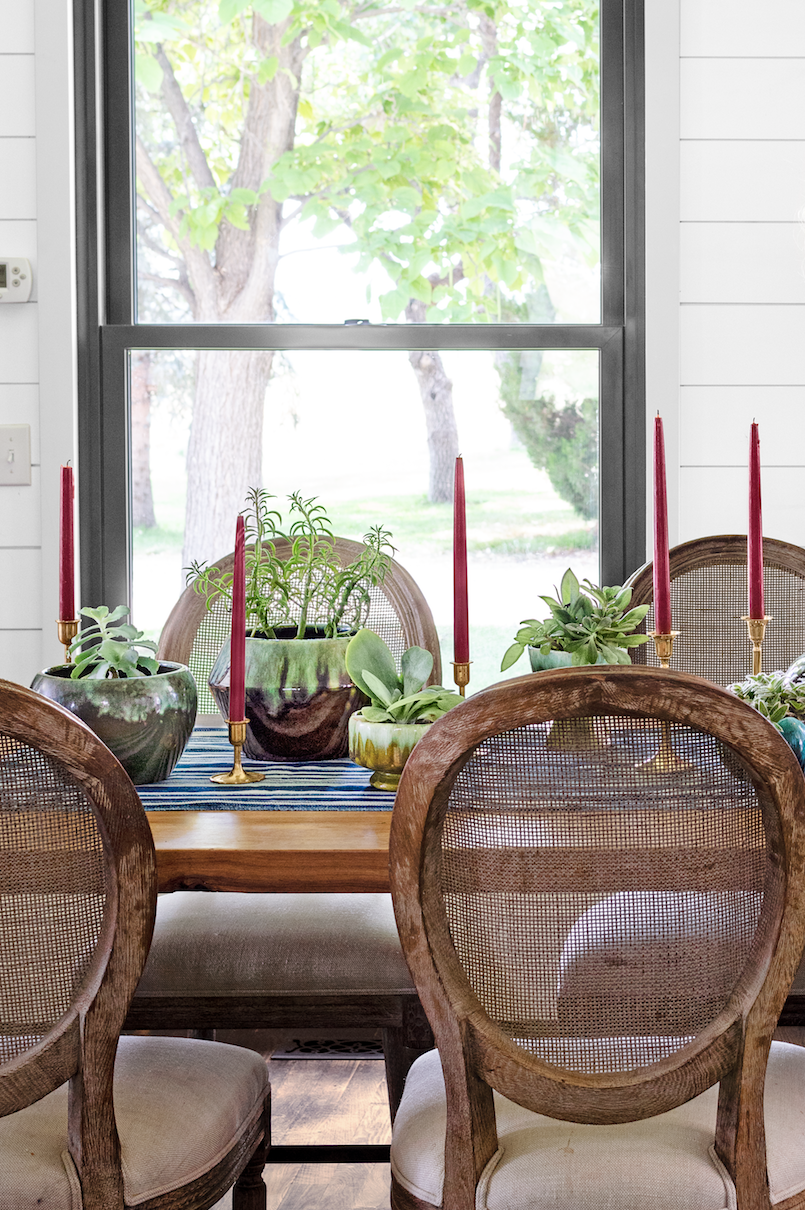 """<p>Let your centerpiece handiwork live on after Thanksgiving with a hardy succulent display. Place a few of these vibrant plants around the table, then simply keep them there—they'll last you well into winter. <a href=""""https://www.amazon.com/Higlow-Dripless-Candles-Tapered-Wedding/dp/B01GD990AC?tag=syn-yahoo-20&ascsubtag=%5Bartid%7C10050.g.2130%5Bsrc%7Cyahoo-us"""" rel=""""nofollow noopener"""" target=""""_blank"""" data-ylk=""""slk:Red taper candles"""" class=""""link rapid-noclick-resp"""">Red taper candles</a>, brass planters, and a blue runner add a splash of color.<br></p><p><strong><a class=""""link rapid-noclick-resp"""" href=""""https://www.amazon.com/Best-Sellers-Garden-Outdoor-Cacti-Succulent-Plants/zgbs/lawn-garden/3745941?tag=syn-yahoo-20&ascsubtag=%5Bartid%7C10050.g.2130%5Bsrc%7Cyahoo-us"""" rel=""""nofollow noopener"""" target=""""_blank"""" data-ylk=""""slk:SHOP SUCCULENTS"""">SHOP SUCCULENTS</a></strong></p>"""