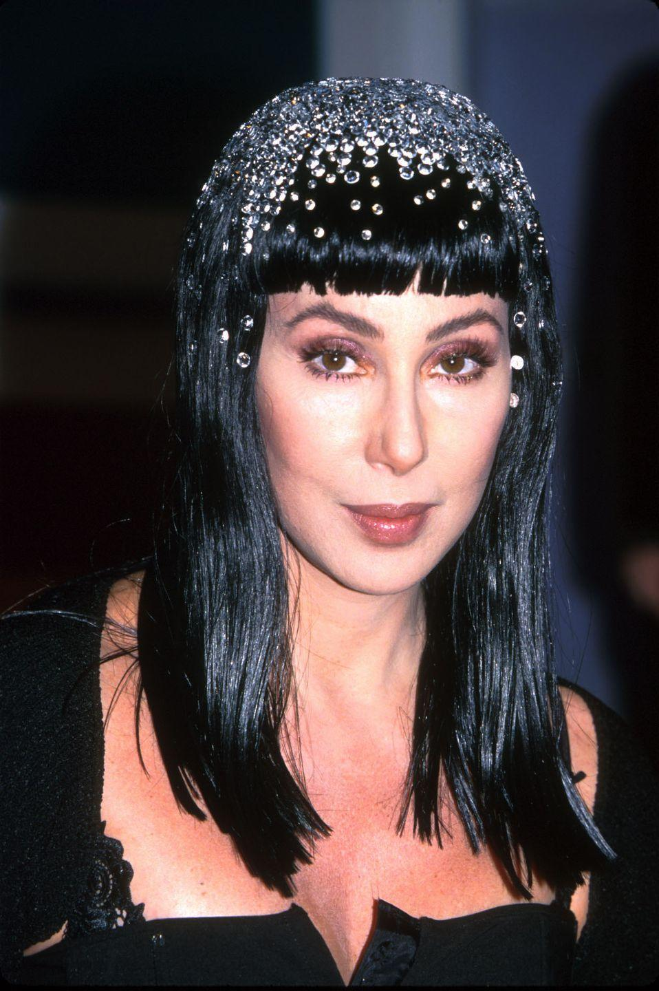 <p>In a bejeweled hairstyle during her <em>Believe</em> era. </p>