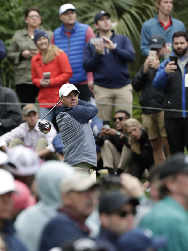 FILE - In this Sunday, March 17, 2019, file photo, Rory McIlroy, of Northern Ireland, tees off on the 15th hole during the final round of The Players Championship golf tournament in Ponte Vedra Beach, Fla. McIlroy doesn't believe he'll play as well without fans at a tournament, amid the coronavirus pandemic. (AP Photo/Lynne Sladky, File)