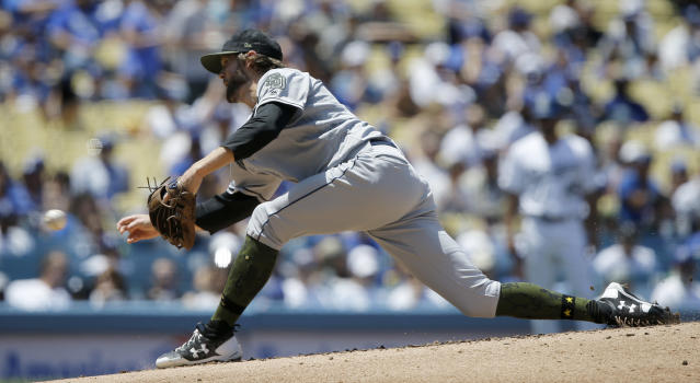 San Diego Padres relief pitcher Adam Cimber throws to the plate against the Los Angeles Dodgers during the third inning of a baseball game in Los Angeles, Sunday, May 27, 2018. (AP Photo/Alex Gallardo)