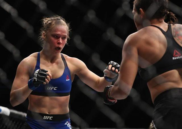 Ronda Rousey reacts after taking a combination of punches from Amanda Nunes. (Getty)