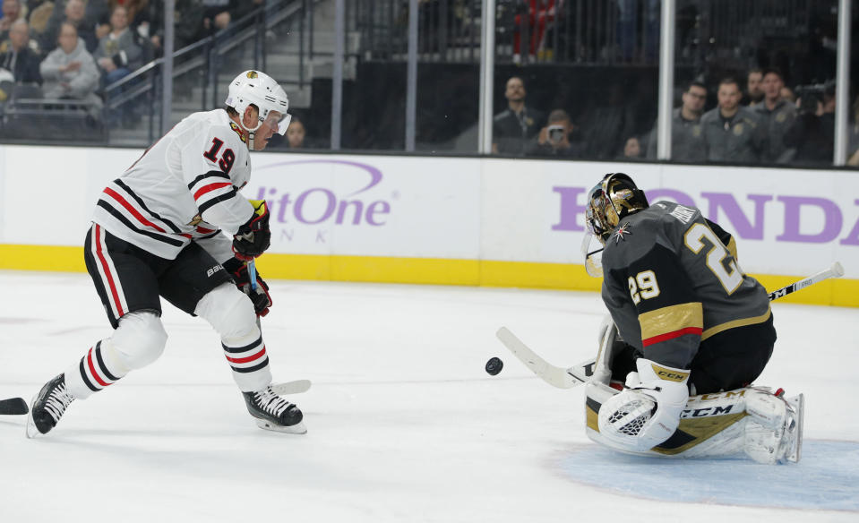 Vegas Golden Knights goaltender Marc-Andre Fleury (29) blocks a shot by Chicago Blackhawks center Jonathan Toews (19) during the first period of an NHL hockey game Wednesday, Nov. 13, 2019, in Las Vegas. (AP Photo/John Locher)