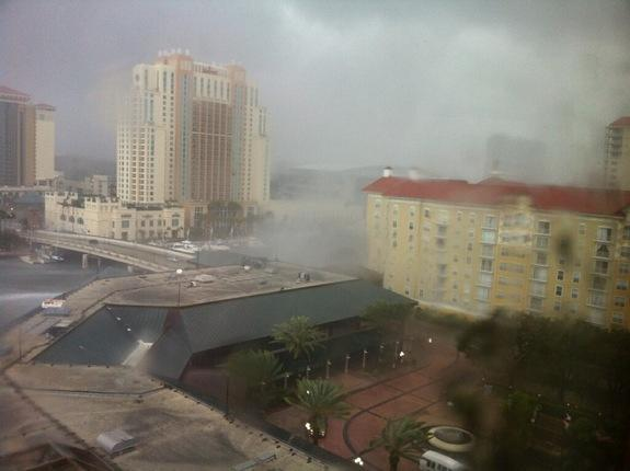 The Tampa waterspout transformed into a tornado when it hit land, damaging roofs and five vehicles.