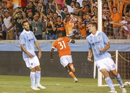 Jul 18, 2018; Houston, TX, USA; Houston Dynamo forward Romell Quioto (31) celebrates after scoring a goal during the second half against Sporting Kansas City at BBVA Compass Stadium. Mandatory Credit: Troy Taormina-USA TODAY Sports