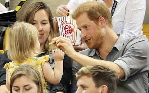 TORONTO, ON - SEPTEMBER 27: Prince Harry (R) sits with David Henson's wife Hayley Henson (L) and daugther Emily Henson at the Sitting Volleyball Finals during the Invictus Games 2017 at Mattamy Athletic Centre - Credit: Chris Jackson/Getty Images